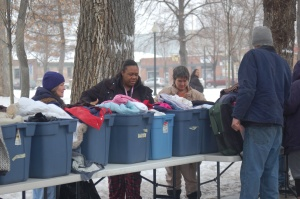 Homeless people pick through bins of used clothing items donated for the Inner-City Outreach ministry January 26.  (Photo By John G. Miller)