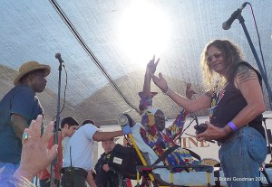 Lester Chambers waves to the crowd as he's wheeled off the stage after being attacked.  (Photo courtesy Bobbi Goodman)