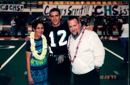 Phyllis and Andy Kotowski with their son Bill in football gear from 1999.  (Photo courtesy Bill Kotowski via Facebook)