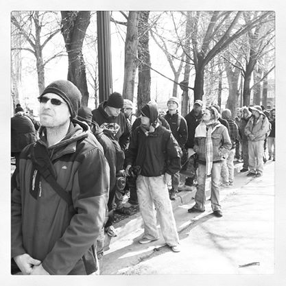 A long line of homeless people line up behind the ICOR truck at Pioneer Park in Salt Lake City in early March. (Photo by John G. Miller)