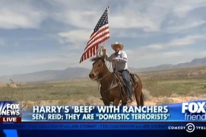 "Cliven Bundy, carrying the flag ""cowboy style."""
