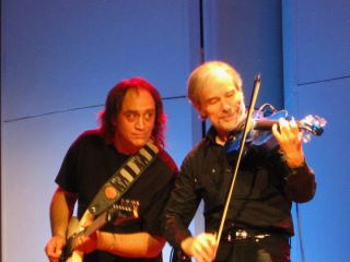 Jamie Glaser plays guitar with his longtime band leader, legendary jazz fusion violinist Jean-Luc Ponty.  (Photo courtesy Jamie Glaser)
