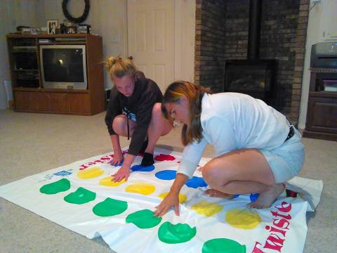 Alicia and Amy engage in a Twister battle. (Photo by John G. Miller)