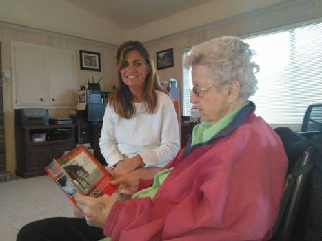 Amy and Mom -- two of the most important ladies of my life -- looking through Amy's children's book. (Photo by John G. Miller)