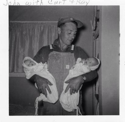 My father, John, with twin babies, Lynda Kay and Curt.